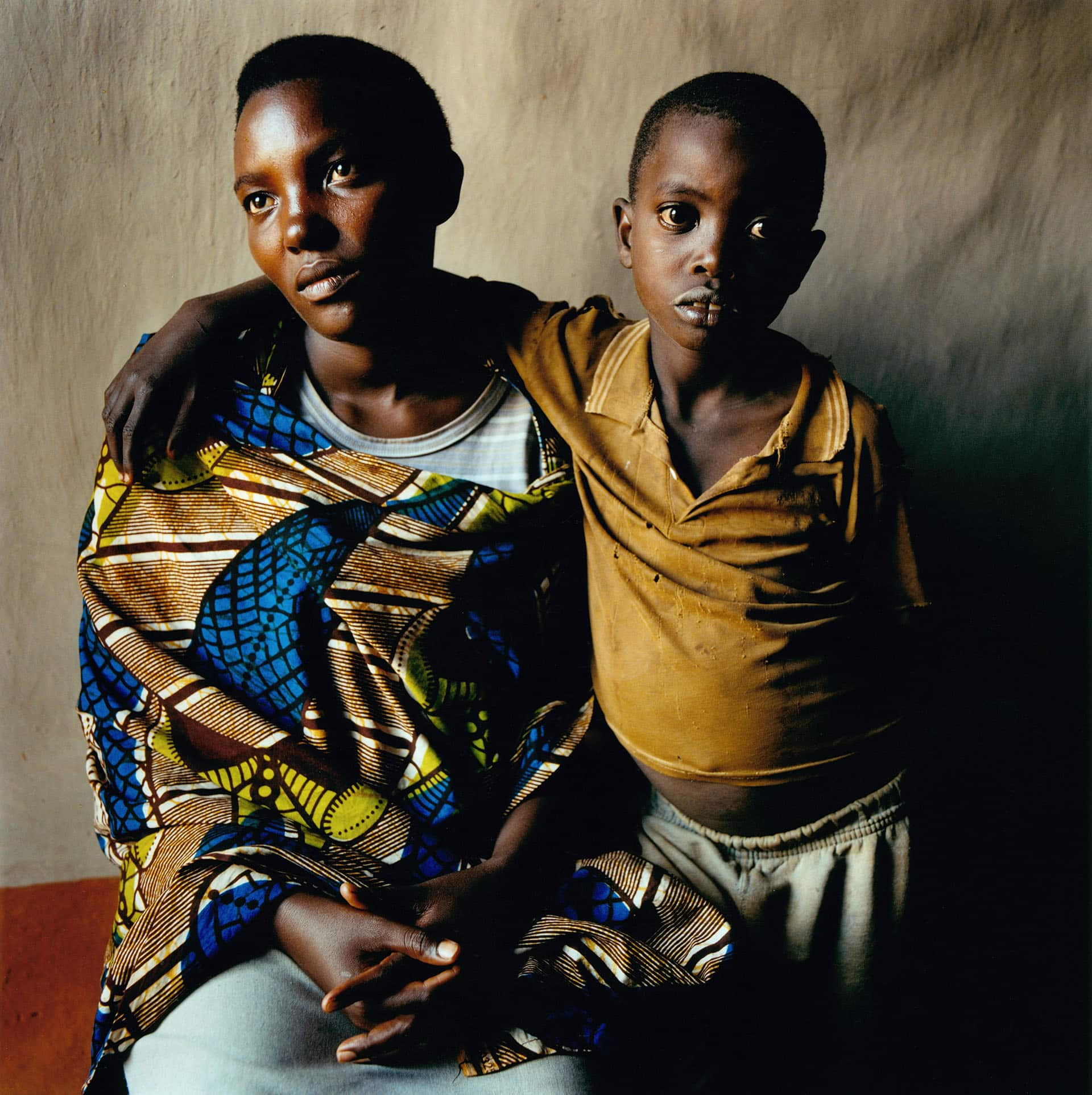 Josianne Ruyange (27), with her son Vedaste Ndikubwimana (11) Mwurire, Rwanda