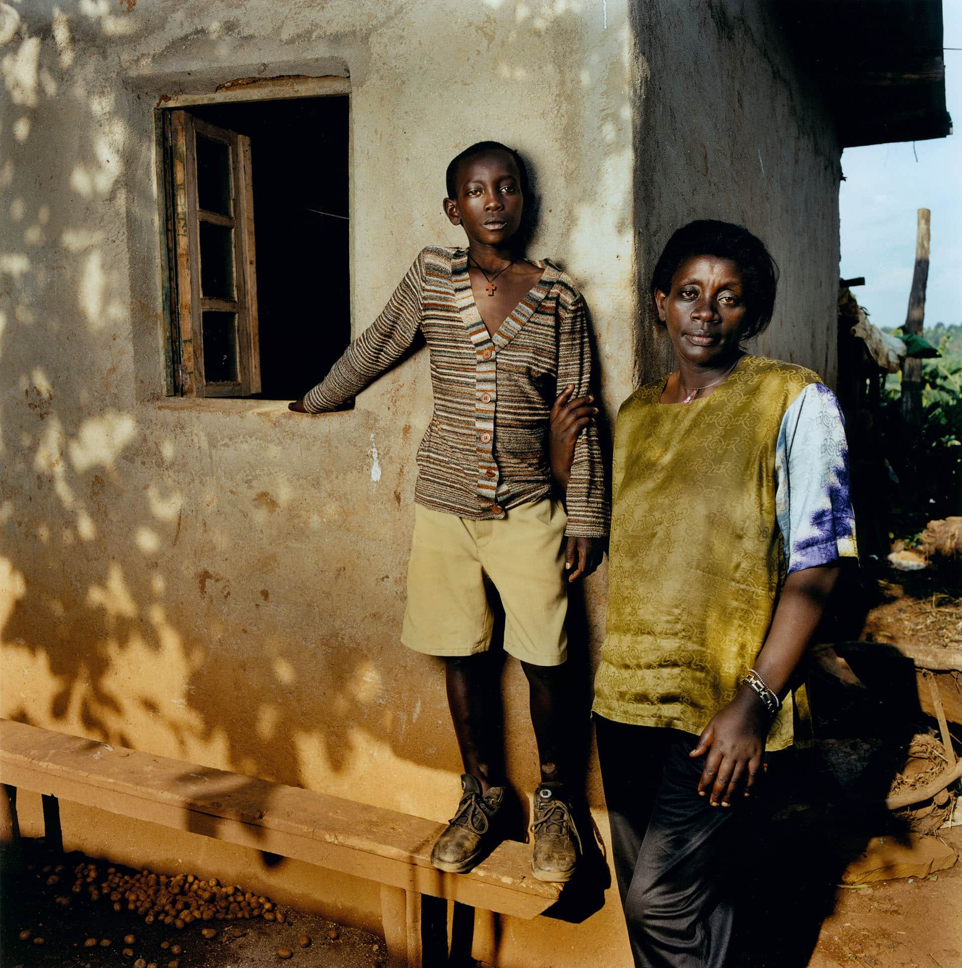 Beatrice Mukayiranga, HIV+ (43) and her son Jean-Baptiste (12).