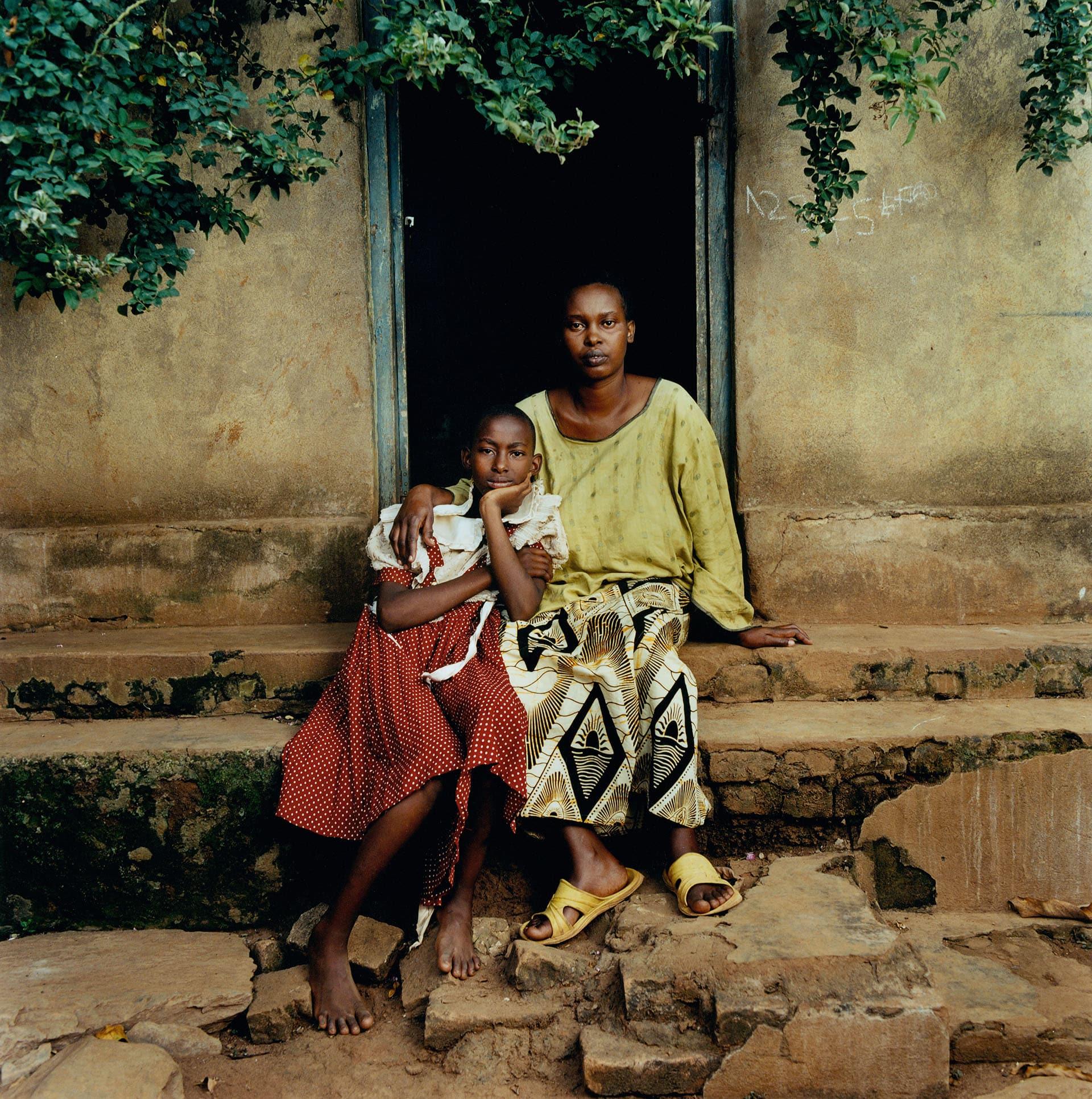 Tausi Mukakarimba (30) and her daughter Isimbi Ariguma (12).