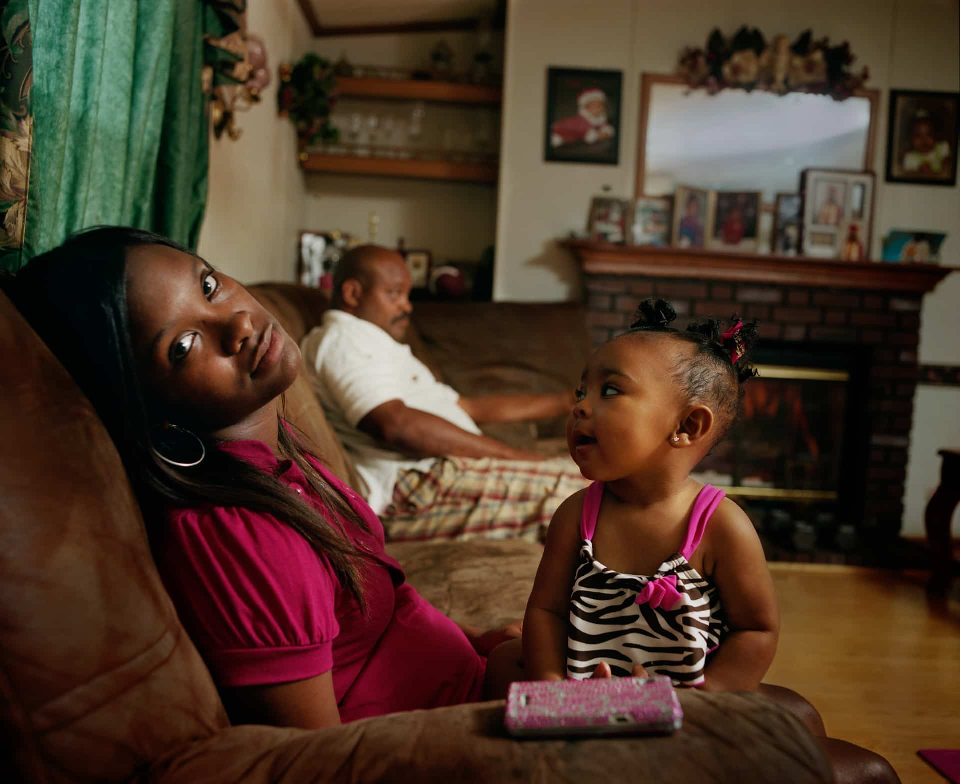 MOUNT VERNON, GEORGIA – 2012: Keyke with her daughter and fath